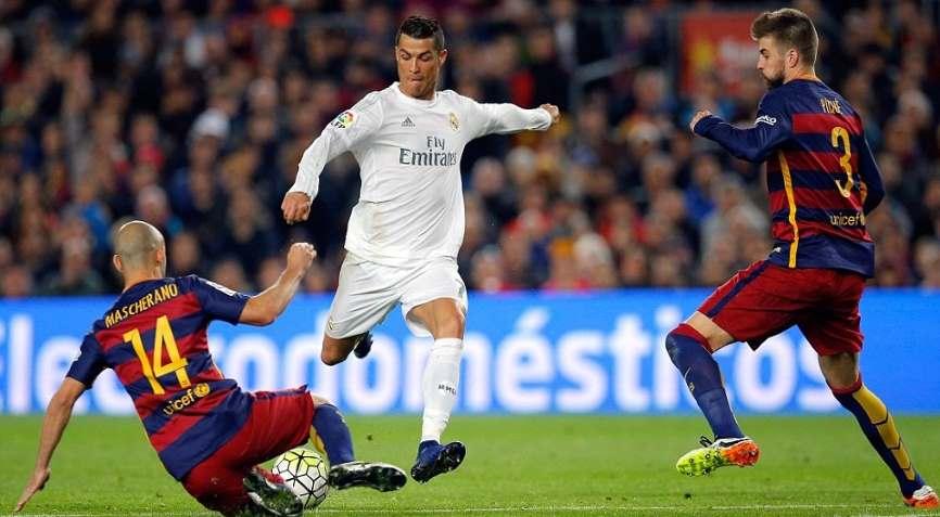 футболисты Барселоны и Реала